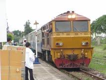 Alsthom Locomotive No. 4214  And Train No52. LAM PHUN , THAILAND - JUNE  29 2007: Alsthom Locomotive No. 4214  And Train No52. Train from Chiangmai to Bangkok Royalty Free Stock Photo