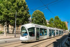 Alstom Citadis 302 tram in Lyon, France. Lyon, France - July 11, 2018: Alstom Citadis 302 tram at Rue Servient in Lyon. Lyon`s tram networks consists of 6 lines royalty free stock images