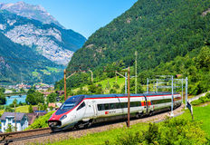 Alstom tilting high-speed train on the Gotthard railway. Erstfeld, Switzerland - July 30, 2016: Alstom ETR 610 tilting high-speed train on the Gotthard railway Stock Images