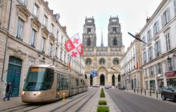 Alstom tram on Jeanne d Arc street in Orleans. Tram on Jeanne d'Arc street in Orleans - France. Cathedral of the holly Cross in backround Royalty Free Stock Photo