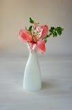 Alstroemeria flower in vase on table Royalty Free Stock Photos