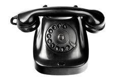 Alt-angeredetes schwarzes telephon mit der Drehskala lokalisiert Stockfoto