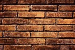 Alt von der konkreten orange Farbe blockiert Wandbeschaffenheitshintergrund Stockfotos
