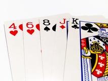 Alta carta in gioco del poker con fondo bianco Fotografia Stock