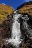 Alta cascata precipitante a cascata potente Fotografia Stock