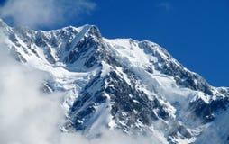 Alta catena montuosa della neve Immagine Stock