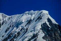 Alta catena montuosa della neve nella regione di Tian Shan Immagine Stock Libera da Diritti