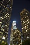 Alta città di aumento alla notte Immagini Stock Libere da Diritti