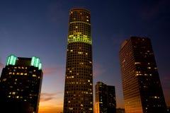 Alta colonna montante del centro al tramonto Fotografie Stock Libere da Diritti