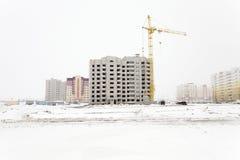 Alta costruzione di aumento che va in su Inverno Fotografie Stock Libere da Diritti