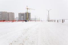 Alta costruzione di aumento che va in su Inverno Fotografie Stock