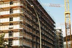 Alta costruzione di aumento che va in su Oggetto non finito di costruzione di nuovo edificio Fotografia Stock