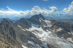 Alta cresta alpina della montagna rocciosa Fotografia Stock Libera da Diritti