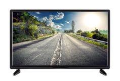 Alta definizione TV piana con la strada della montagna sullo schermo Fotografie Stock Libere da Diritti