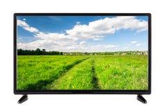 Alta definizione TV piana con una strada campestre sullo schermo Fotografia Stock