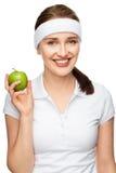 Alta giovane donna chiave del ritratto che giudica mela verde isolata su wh Fotografie Stock