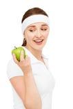 Alta giovane donna chiave del ritratto che giudica mela verde isolata su wh Immagine Stock