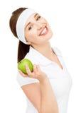 Alta giovane donna chiave del ritratto che giudica mela verde isolata su wh Immagini Stock