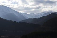 Alta montagna con la nuvola Immagine Stock