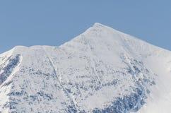 alta montagna ripida con neve Immagine Stock