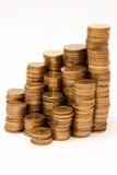 Alta pila de monedas Foto de archivo