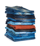 Alta pila di jeans colorati Fotografie Stock
