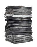 Alta pila di jeans grigi e neri Fotografie Stock