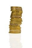 Alta pila di monete Immagine Stock
