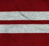 Struttura del tessuto di cotone - rosso con le bande grige Fotografie Stock