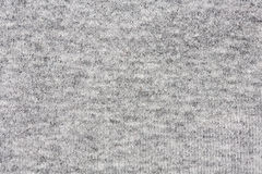 Alta risoluzione vicina su di tessuto grigio con l'attraversamento delle cuciture. Fotografia Stock