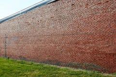 Alta struttura rossa del fondo del muro di mattoni Fotografie Stock