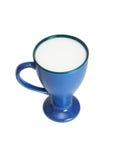 Alta taza azul de leche aislada Imágenes de archivo libres de regalías