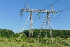 Alta tensione del palo di potere del pilone di elettricità Immagine Stock