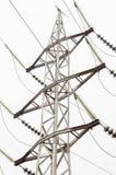 Alta tensione elettrica della torre su bianco Fotografia Stock