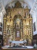 Altaarstuk en de koepel op de belangrijkste kapel van de kerk van Onze Dame van Gunst, Almeria, Andalusia, Spanje stock foto's