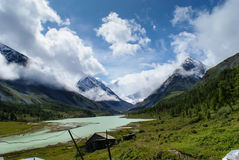 Clouds and mountain river. Beautiful mountains , blue sky and turquoise lake Stock Photos