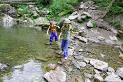 Altai. Children moving mountain creek Royalty Free Stock Photography