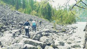 Altai, Kucherla, Russia - June, 20, 2018: Tourists in the Altai forest. Uphill. Adventure and adventure tourism. Altai, Kucherla, Russia - June, 20, 2018 stock video footage