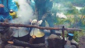 Altai, Kucherla, Russia - June, 20, 2018: Tourists in the Altai forest. Uphill. Adventure and adventure tourism. Altai, Kucherla, Russia - June, 20, 2018 stock video
