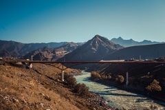 Altai mountains with tree house road. And bridge through river Stock Photography