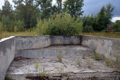 Abandoned swimming pool in the tourist complex `Eldorado` at the mouth of the river Ini Altai Krai. ALTAI REGION, RUSSIA - SEPTEMBER 3, 2018: Abandoned swimming stock image