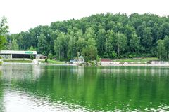 Cafe on the shore of the mountain lake Aya. stock photography