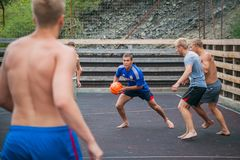 Altai, Russia August 08, 2018. Altai, Russia – August 08, 2018:  young teenagers playing basketball on the basketball court at a children`s camp in the royalty free stock image