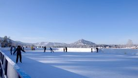Altai, Russia - January 2, 2019: Rink in mountains. Winter holiday scene. Outdoor rink. Mountain lake scenery landscape. Skating o stock footage