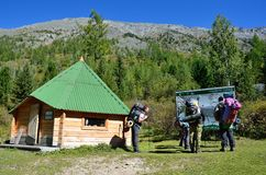 Altai territory, Ust-Koksinsky district, Russia, September, 02, 2016. tourists looking for Visit center and map of the sites in K. Altai, Ust-Koksinsky district royalty free stock photo