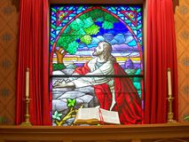 Altar. Bible in front of stained glass window Stock Image
