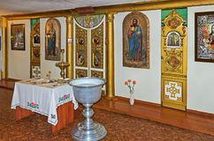 Altar. A baptismal font, a throne and altar in the room for the performance rite of baptism in the Orthodox Church Royalty Free Stock Images