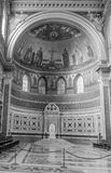 Altar with the bishop's throne with a marble wall and floor in the central part of the dome in Basilica di San Giovanni in. Laterano in Rome stock images