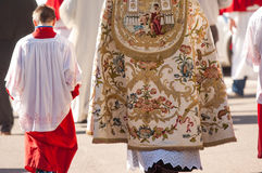 Altar boy and priest Stock Images