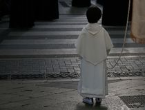 Altar boy seen during an easter holy week procession in mallorca. An Altar boy stands in the street during the procession of Saint christ of Santa Cruz during stock images
